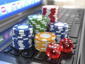 Virtual casino. Online gambling. Laptop with dice and chips.
